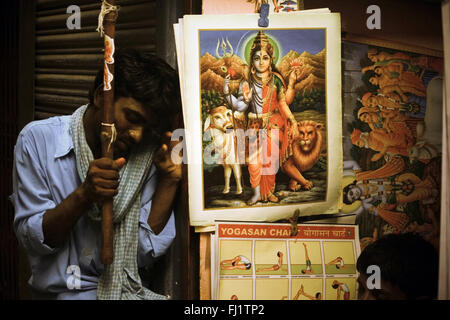Icon of Lord Shiva in street of Varanasi, India - Stock Photo