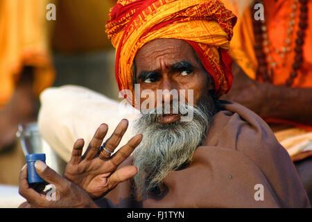 Portrait of Indian man in Hindu holy city Varanasi, India - Stock Photo