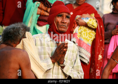 Hindu pilgrims in holy city Varanasi, India - Stock Photo