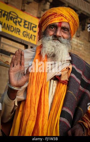 Portrait of Indian man sadhu in Hindu holy city Varanasi, India - Stock Photo