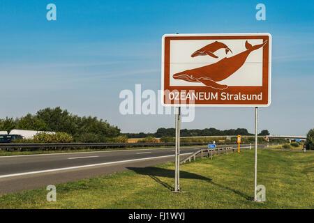 Tourist sign to the Ozeaneum Stralsund on the German Highway (Autobahn) A20, Schwerin, Mecklenburg-Western Pomerania, - Stock Photo