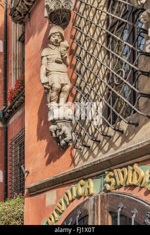 The figure of the drunken reveler is located above the entrance to the Schweidnitzer Cellar, Wroclaw, Poland, Europe - Stock Photo