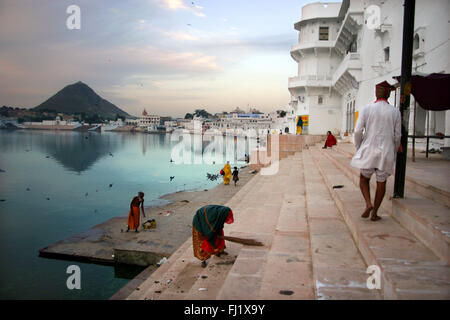 Hindy pilgrims gather around holy lake of Pushkar  , Rajasthan , India - Stock Photo