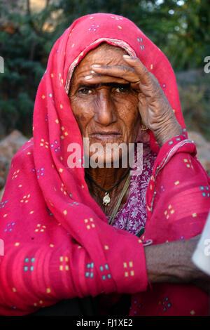 Indian hindu woman during Pushkar mela-  Pushkar camel fair in Rajasthan, India - Stock Photo