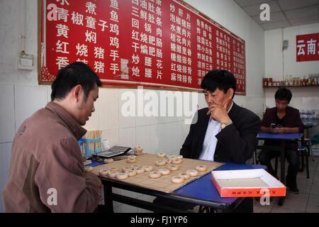 Two men playing chess in Kunming,  China - Stock Photo