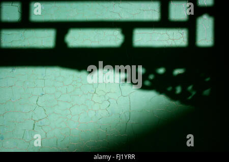 Shadow on a wall in a temple in  Yunnan province , China - Stock Photo