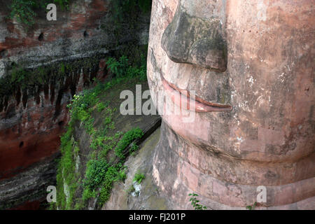 Close up on mouth of Leshan Giant Buddha , Sichuan , China - Stock Photo