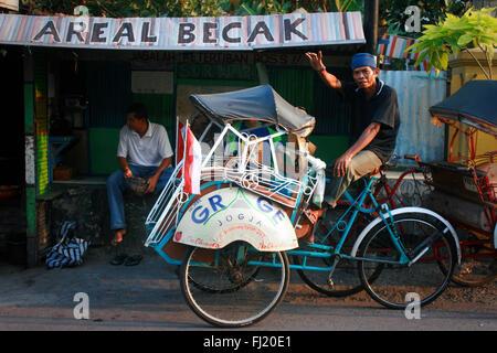 Becak driver in Jakarta, Indonesia - Stock Photo