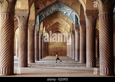 Child running inside Vakil mosque, Shiraz, Chiraz , Iran - Stock Photo