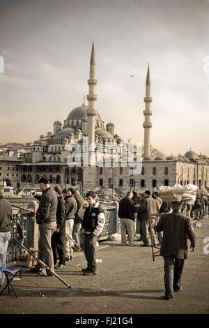 Yeni Cami (the «New Mosque») dominates the ferry docks at the southern end of Istanbul's Galata Bridge, - Stock Photo