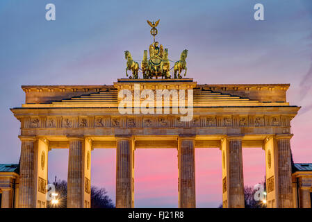 The famous Brandenburg Gate in Berlin after sunset - Stock Photo
