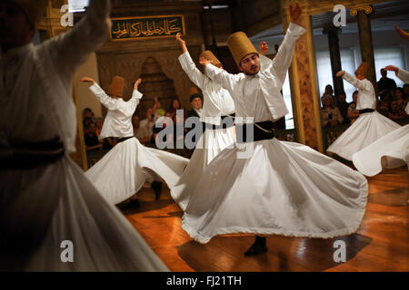 Whirling Dervishes perform at Hodjapasha Culture Centre, Istanbul - Stock Photo