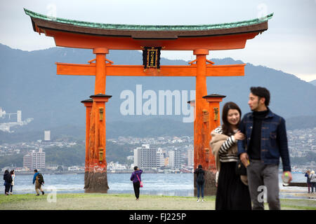 Itsukushima Shrine is a Shinto shrine on the Itsukushima island (popularly known as Miyajima), best known for its - Stock Photo