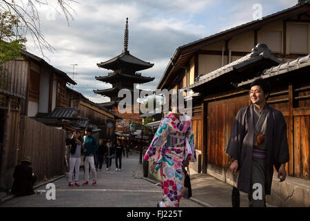 Couple of lovers with kimono walk in the streets of Kyoto , Japan - Stock Photo