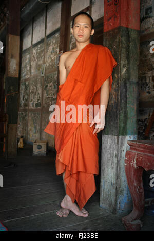 Portrait of buddhist monk in monastery Luang Prabang , Laos, Asia - Stock Photo