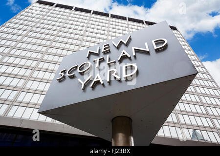 New Scotland Yard before its move in 2016.  Sign outside the Metropolitan Police headquarters, Broadway, Victoria, - Stock Photo
