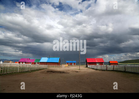 Houses with colored roofs in Tsagaan Nuur village  , Mongolia - Stock Photo