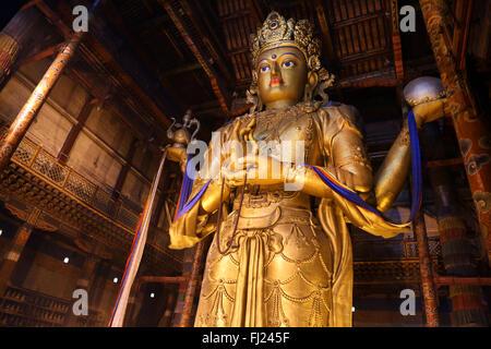 Huge Avalokiteśvara statue in Gandantegchinlen Monastery, Ulaanbaatar, Mongolia - Stock Photo