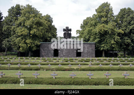 The entrance crypt viewed across some of the crosses/headstones in the Lommel German war cemetery, Lommel, Belgium. - Stock Photo