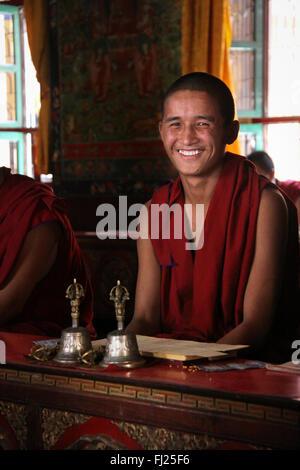 Portrait of Nepali buddhist monk in Sakya Tharig gompa monastery in Boudhanath - Stock Photo