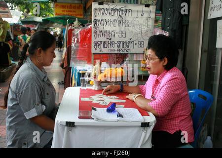 Fortune-teller in Bangkok, Thailand - Stock Photo
