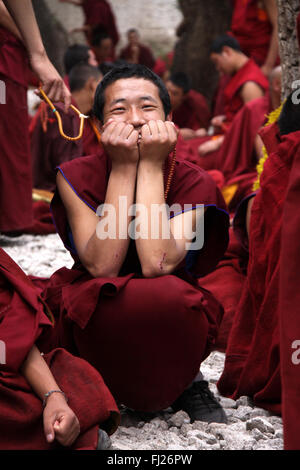 happy tibetan monk in Jonkhang temple, Lhasa - Stock Photo