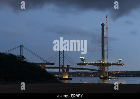 North bank and North Pier of Queensferry Crossing under construction at dusk, looking towards South Queensferry, - Stock Photo
