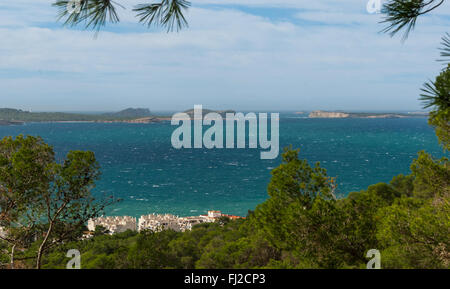 Hill side view from St Antoni de Portmany, Ibiza, into balearic sea on a clearing day in November, famous distant - Stock Photo