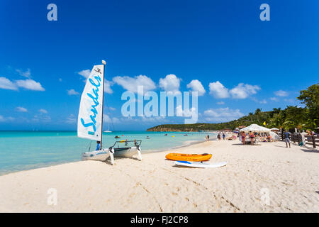 Sandals Hobie catamaran on the pristine Dickenson Bay beach, north Antigua, Antigua and Barbuda, West Indies on - Stock Photo