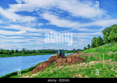 Construction of Vitebsk hydroelectric power station. Preparation of the river bank near village for protection against - Stock Photo