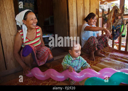 Three generations share a house in a SHAN VILLAGE near KENGTUNG also known as KYAINGTONG - MYANMAR - Stock Photo