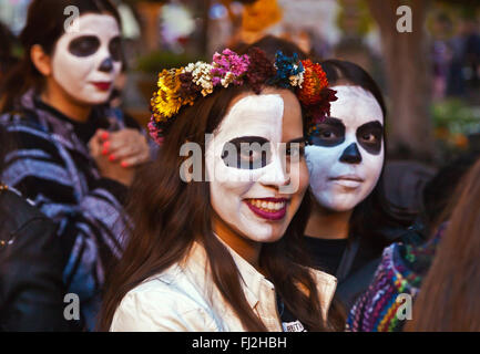 Faces are painted like skulls as people transform themselves into CATRINAS during DAY OF THE DEAD  -  SAN MIGUEL - Stock Photo