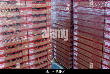 Boxes of fresh strawberries waiting to be put on sale in store - Stock Photo