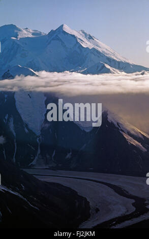 MOUNT MCKINLEY also known as DENALI rises above the clouds - DENALI NATIONAL PARK, ALASKA - Stock Photo