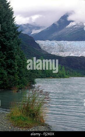MENDENHALL GLACIER as seem frp, MENDENHALL LAKE - JUNEAU, ALASKA - Stock Photo