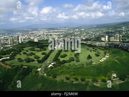 HONOLULU and the NATIONAL CEMETERY by helicopter - OAHU, HAWAII - Stock Photo