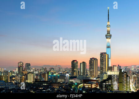 Tokyo; Japan -January 9; 2016: Tokyo Skyline at dusk, view of Asakusa district, Skytree visible in the distance. - Stock Photo