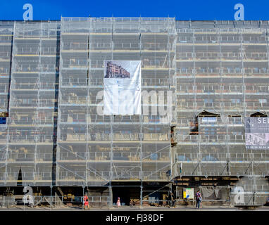 Scaffolding with safety net on 'Gallia' student residence building undergoing renovation, Strasbourg, Alsace, France - Stock Photo