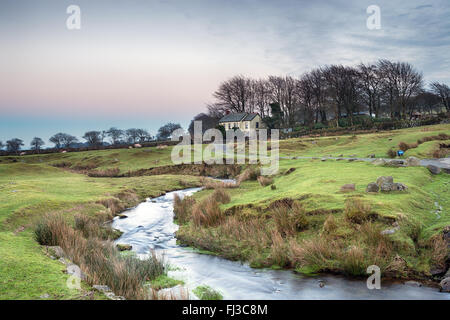 A bleak lonely cottage on Dartmoor National Park in Devon - Stock Photo