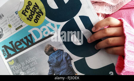 London, UK. 29th February, 2016. A person reads the New Day newspaper.  The New Day - a new national daily newspaper - Stock Photo