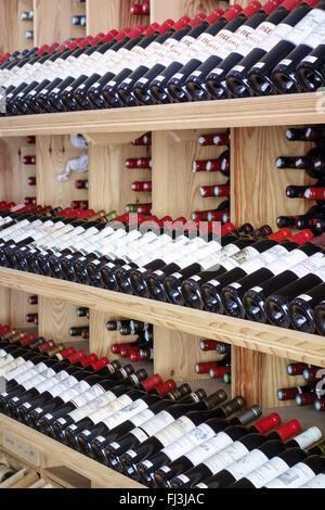 Racks of Bordeaux wines on sale, Saint Emillion, France - Stock Photo