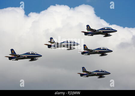 The Italian Frecce Tricolori Display Team flying in formation at the RIAT Air Show at RAF Fairford, Gloucestershire, - Stock Photo