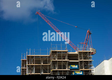 Construction Site of Flats with Scaffolding and a Crane in Bournemouth, Dorset, England, UK - Stock Photo