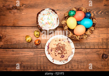 Traditional Easter cake, quark dessert and easter eggs on the wooden table. top view - Stock Photo