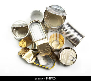 Pile of tin cans waiting to reuse. - Stock Photo