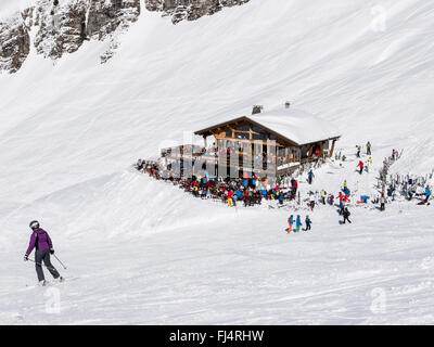 Le Blanchot Alpine ski restaurant busy with skiers on snow slopes in Le Grand Massif ski area of French Alps. Flaine, - Stock Photo