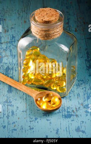 Cod Liver Oil Capsules in old bottle - Stock Photo
