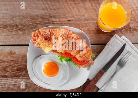 sandwich croissant with fried bacon cheese tomato breakfast and egg - Stock Photo
