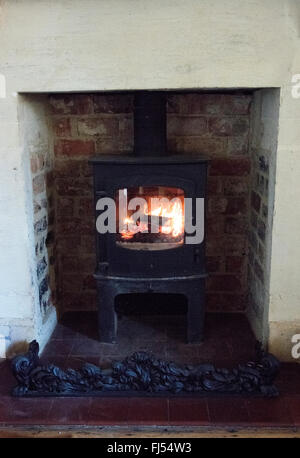 Brick Fireplace With Wood Burning Stove And Flatscreen Television Stock Photo Royalty Free