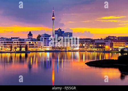 Lake Phoenix and Florianturm telecommunications tower in the evening, Germany, North Rhine-Westphalia, Ruhr Area, - Stock Photo